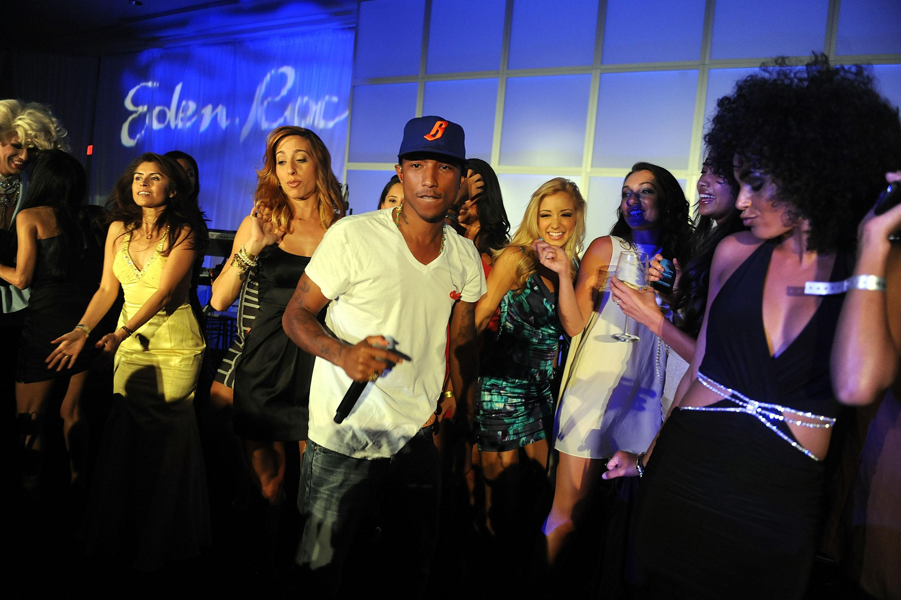 MIAMI BEACH, FL - APRIL 02:  Singer Pharrell Williams performs at the gala to benefit at-risk youth at Eden Roc Hotel on April 2, 2011 in Miami Beach, Florida.  (Photo by Gustavo Caballero/Getty Images for The Blacks' Annual Gala) *** Local Caption *** Pharrell Williams